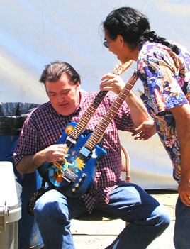David Hidalgo of Los Lobos with Ray Cepeda back stage fooling around with Rays double neck. David Hidalgo is the only one who can play it besides Ray.